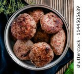 fried meat cutlets in a bowl.... | Shutterstock . vector #1144505639