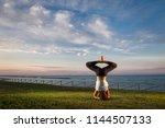 young girl practice yoga... | Shutterstock . vector #1144507133