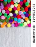 a colorful  pom pom background... | Shutterstock . vector #1144515293