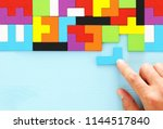 man's hand holding a square... | Shutterstock . vector #1144517840