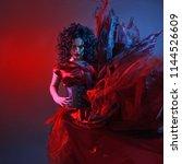 gothic girl in red. dancing... | Shutterstock . vector #1144526609