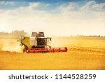 combine harvester working on... | Shutterstock . vector #1144528259