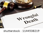 Small photo of Wrongful Death report and gavel in a court.