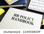 hr policy handbook on an office ... | Shutterstock . vector #1144538339