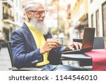 happy senior businessman using... | Shutterstock . vector #1144546010