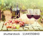 glass of red wine ripe grapes... | Shutterstock . vector #1144550843
