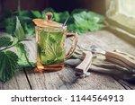 healthy nettle tea or infusion  ... | Shutterstock . vector #1144564913