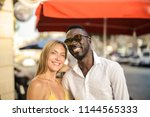afro man and blonde woman in... | Shutterstock . vector #1144565333