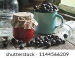 jar of black currants jam ... | Shutterstock . vector #1144566209