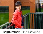 attractive mid aged woman... | Shutterstock . vector #1144592870