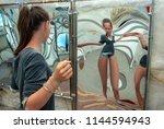 attraction  girl looking at her ... | Shutterstock . vector #1144594943