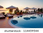 swimming pool of luxury hotel | Shutterstock . vector #114459544