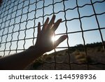 Male Human Hand Touching Fence...