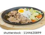 sliced pork steak on hot plate  ...   Shutterstock . vector #1144620899