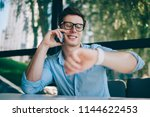 successful young man laughing... | Shutterstock . vector #1144622453