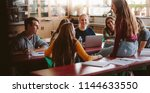 group of young people sitting... | Shutterstock . vector #1144633550
