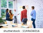 group of startup entrepreneurs... | Shutterstock . vector #1144636016
