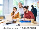 coworkers discussing ideas... | Shutterstock . vector #1144636040