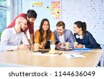 young startup businesspeople... | Shutterstock . vector #1144636049