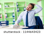 employee doing exercises during ... | Shutterstock . vector #1144643423