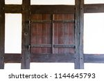 a closed window with wooden... | Shutterstock . vector #1144645793