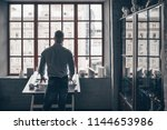 mature man by the window in the ... | Shutterstock . vector #1144653986