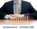 businessman saveing for... | Shutterstock . vector #1144661180