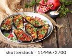 baked eggplants with... | Shutterstock . vector #1144672700