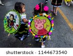 Small photo of Santa Elena, Medellín, Antioquia, Colombia, July- 22 - 2018. 600 silleterites between the age of 4 months to 12 years, anticipate the flower fair in the village of Santa Elena in Medellín.