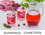 red cherry cocktail with ice...   Shutterstock . vector #1144675556