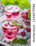 red raspberries cocktail with...   Shutterstock . vector #1144675586