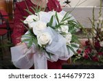 woman with roses boquet in her... | Shutterstock . vector #1144679723