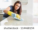 Concentrated Woman Scrubbing...