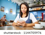 young businesswoman in smart... | Shutterstock . vector #1144705976