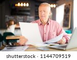 businessman reading papers and...   Shutterstock . vector #1144709519