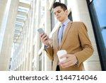 serious employee in formalwear...   Shutterstock . vector #1144714046