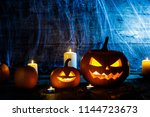 Stock photo jack o lantern halloween pumpkins spiders on web and burning candles 1144723673