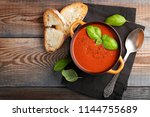 homemade tomato soup with basil ... | Shutterstock . vector #1144755689