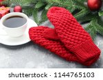 knitted red gloves with cup of... | Shutterstock . vector #1144765103