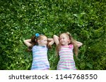 two little beautiful girls lie... | Shutterstock . vector #1144768550