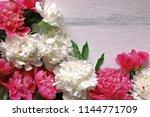 peonies on wooden background    Shutterstock . vector #1144771709