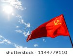 red communist flag of the ussr... | Shutterstock . vector #1144779110