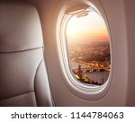 airplane interior with window... | Shutterstock . vector #1144784063