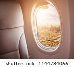 airplane interior with window... | Shutterstock . vector #1144784066