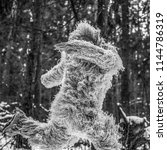 Stock photo yeti fairy tale character in winter forest outdoor fantasy black white photo 1144786319