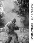 Stock photo yeti fairy tale character in winter forest outdoor fantasy black white photo 1144786349