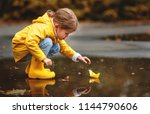 happy child girl with umbrella... | Shutterstock . vector #1144790606