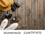 journey accessories on old wood ... | Shutterstock . vector #1144797470