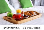 breakfast on tray in bed in... | Shutterstock . vector #1144804886