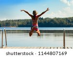 young girl jumping into water ... | Shutterstock . vector #1144807169